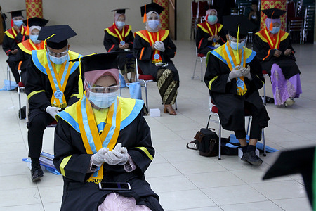 Students pray at the end of the Graduation Ceremony during the pandemic at the State Islamic University of Palembang, South Sumatra, Saturday, January 30, 2021
