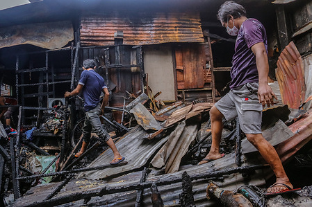 A second alarm fire hit the Muslim Community in 18th Avenue, Cubao, Quezon City on the morning of January 30, 2021. Residents went back to their property to look for things that are still available to use.