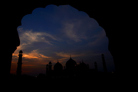 Sunset view of Badshahi Mosque; it is one of the few architectural monuments built during Emperor Aurangzeb's rule from the year 1658 to 1707.  It is presently the fifth largest mosque in the world and was indisputably the largest mosque in the world from 1673 to 1986 when the Faisal Mosque was constructed in Islamabad.