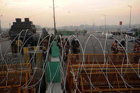 A barbed wire fence set up at Gjazipur border for cut off farmers protesting near Delhi.