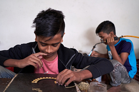 Workers are making copper and silver jewelry during the Covid-19 outbreak at Bhakurta village in Savar near to the capital. There are more than 2400 families involved in this trade and 500 shops in total.