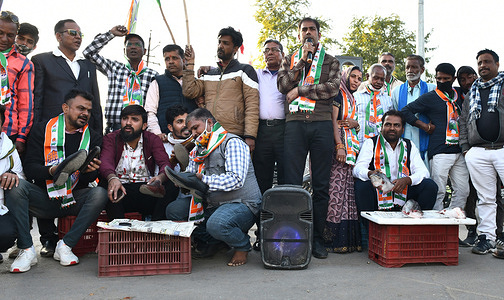 Congress workers polishes shoes and sold fishes during a protest against Indian Prime Minister Narendra Modi's government over alleged unemployment after union budget 2021, in Beawar. Youth activists also beat their chest and shouted slogans against BJP and PM Modi.