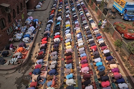 Thousands of Muslim devotees took part in the Jumma prayer at Dhanmondi in Dhaka. Due to lack of adequate space in the mosque, people attended the congregation on the street.