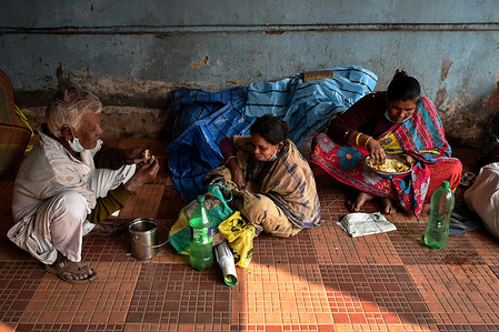 People are taking their lunch inside at  Hospital in Kolkata.