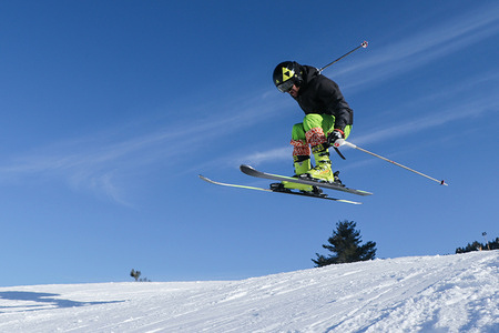 A skier in action at the famous ski resort during a sunny day in Gulmarg. Gulmarg was transformed into one of the favorite ski destinations in Jammu and Kashmir and many consider it to be one of the world's best ski resorts.