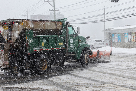 Snow plow truck  during snow storm  day on Connecticut Ave.