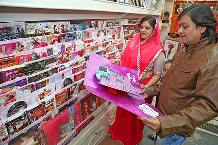 A couple chooses greetings cards in a gift store for the forthcoming Valentine Day celebrations in Beawar.