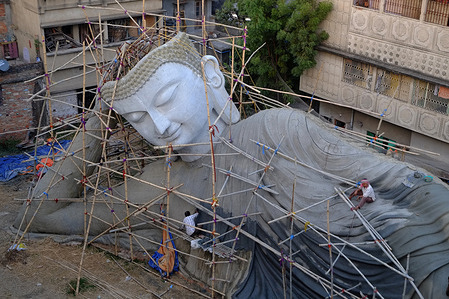Artists are preparing the largest lying Buddha statue of 100 feet that will be set at Bodhi Gaya religious site in Bihar.