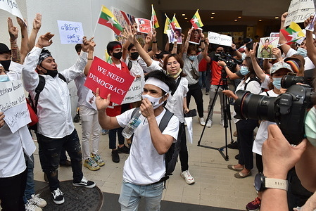 Myanmar citizens living in Thailand protest against the Burmese military coup at the Pathumwan intersection.