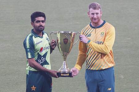 Pakistani and South Africa Twenty20 team cricketers take part in the team practice session at the Gaddafi Cricket Stadium in Lahore ahead of the first T20 cricket match between Pakistan and South Africa. Pakistan's cricket team captain Babar Azam (L) and South Africa's cricket team captain Heinrich Klaasen pose for a picture with the T20 trophy during a ceremony at the Gaddafi Cricket Stadium in Lahore on February 10, 2021 ahead of the first T20 cricket match between Pakistan and South Africa.