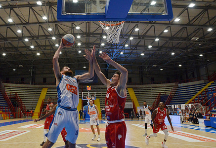 With white shirt the player of Napoli Basket and with red shirt player of Pistoia, they fight for the ball during the match played at Palabarbuto sports hall of Naples, the Napoli Basket won vs Pistoia 79-64 in the match for the Serie A2 League.