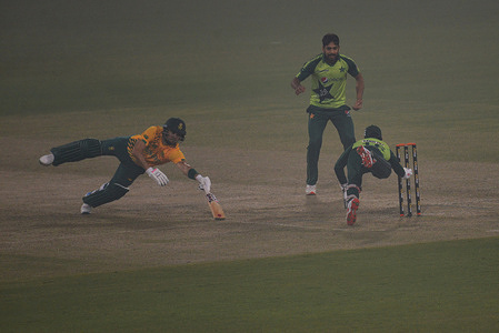 A view of the first Twenty20 cricket match between Pakistan (Green Shirts)and South Africa (Yellow Shirts)at the Gaddafi Cricket Stadium in Lahore. Pakistan Thursday defeated South Africa by three runs in the first T20 match in Lahore's Gaddafi Stadium, with the fabulous ton of Mohammad Rizwan, He made 104 runs off 63 balls with seven 6s and five 4s. Pakistan set a respectable target of 170 runs for visiting team. However, bowling-line especially Usman Qadir managed to restrict Proteas to 166 score in 20 overs.
