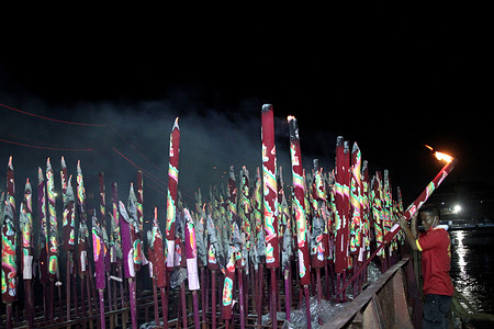 Indonesian Chinese Citizens Conduct the ritual of burning large incense sticks during the Chinese New Year Celebration during the pandemic in Palembang South Sumatra Indonesia