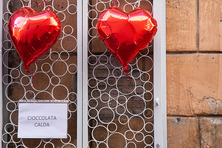 On the occasion of Valentine's Day, a bar near Campo de Fiori in Rome displayed two red heart-shaped balloons