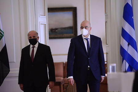 Iraqi Foreign Minister Fouad Hussein (left) and Greek Foreign Minister Nikos Dendias (right) during their meeting in Athens.