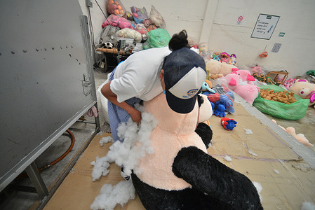 A worker of 'Andy Toys factory' during the manufacturing process of a teddy bear for valentine's day celebrations amid covid pandemic; the Andy Toys factory which has been dedicated to the production of teddy bears, for more than 35 years, in valentine's season their manufacture more that 500 teddy figures daily with sizes range from 15cm to 1.80 cm on February 12, 2021 in Xonactlan, Mexico