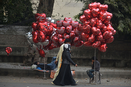 Pakistani people buying fresh roses and garlands for their loved ones ahead of Valentine's Day as the demands of flowers high at a big flower whole sale liberty market in Lahore. Valentine's Day, also known as Saint Valentine's Day or the Feast of Saint Valentine is observed on February 14 each year. It is celebrated in many countries around the world, although it is not a public holiday.