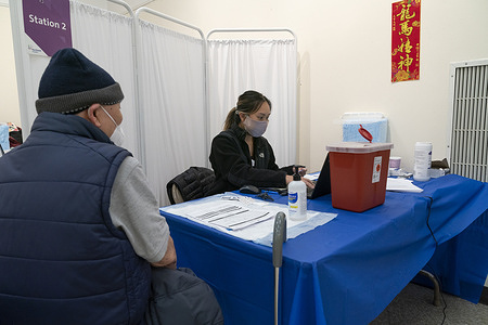 NorthWell Health System nurse enters data about patient before administering vaccine at community-based pop-up vaccination site in Chinatown at Confucius Plaza Community Center. Pop-up site was managed by NorthWell Health System personnel and activated on order by Governor Andrew Cuomo