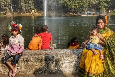 The youths wearing yellow dresses and flower ornaments celebrating Pohela Falgun (Boshonto utsav), a festival welcoming the advent of spring. Since 2020, the day has coincided with Valentine's Day on February 14. Valentine day also observed today which is also much popular to youths.
