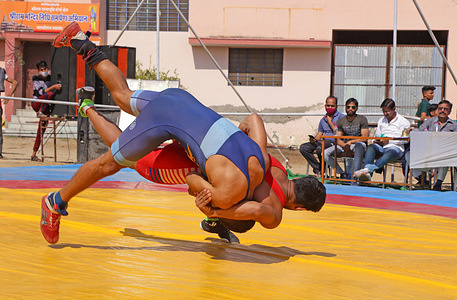Wrestlers in their match during state level Greco-Roman wrestling championship in Beawar.