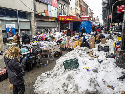 Street vendors, some of them illegal, overtaking streets of Bensonhurst trying to survive during pandemic time. Folding tables, closing racks, boxes with merchandise blocking pedestrians from walking freely on the street.