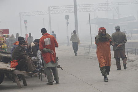 """Pakistani students going to school during fog engulfs the provincial capital City Lahore. Commuters on their way during the intensity of the fog, visibility was reduced low, making it difficult for vehicles tomaneuveron the roads. The traffic police have issued safety guidelines for people after the fog rolled into the city. """"Fog has its own criteria under which it develops the visibility must reduce to less than 1 kilometre, the humidity levels must be more than 90 per cent, the air must be still and the sky clear."""