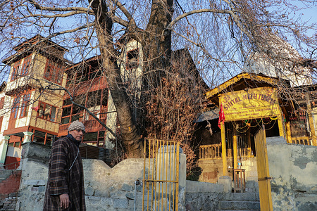 SRINAGAR, INDIA, 16 FEBRUARY 2021 - A Kashmiri Pandit stand outside of Historic Shital Nath Temple after a special puja held at temple after 31 years on the occasion of Basant Panchami in the heritage city of Srinagar, Jammu and Kashmir.
