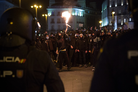 Several protesters confront the police in Puerta del Sol in Madrid, during the protest over the imprisonment of rapper Pablo Hasel.