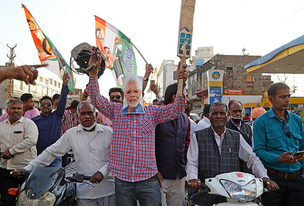 Congress party activist wearing facemask of PM Narendra Modi demonstrate at a petrol pump during protest against hike in fuel prices, in Beawar. Petrol prices crossed rupees 100 per litre mark in Rajasthan after fuel rates were hiked for the ninth day in a row.