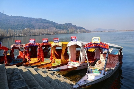 Shikara boats remain empty on the banks of dal lake during the visit of foriegn delegation members to the Kashmir valley.