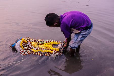 Immersion of Saraswati idols at Ganga river during Saraswati festival in Kolkata.