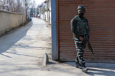 SRINAGAR, INDIA, 19 FEBRUARY 2021 - A paramilitary trooper cordon off the area where two policemen killed in an attack by militant in the Baghat area of Srinagar on Friday. This is the second attack in the city in the past three days. These attacks in the city surged in the light of a 24-member delegation of envoys from various countries visited Jammu and Kashmir on Wednesday for assessing the ground situation in the union territory.