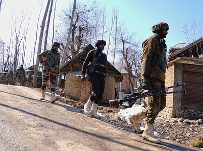 Paramilitary personnel holding arms and ammunition walking in queue as they are moving towards an encounter site in Beerwah area of budgam district on 19-02-2021.During encounter one policeman got killed and another get injured.