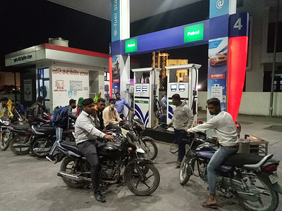 Petroleum station attendant pumps petrol into a bike at a petrol pump in Beawar. Petrol and diesel prices hiked for the eleventh consecutive day in India. Petrol crossed rupees 100-mark per litre and diesel at rupees 89 on Friday.