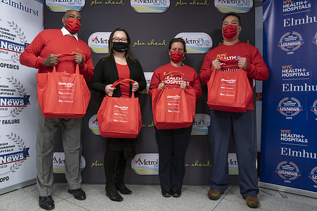 (L-R) MetroPlus Chief Growth Officer Roger Milliner, President and CEO MetroPlus Health Plan Talya Schwartz, CEO of Elmhurst Hospital Helen Arteaga Landaverde, Senior Vice President and Chief Quality Officer for New York City Health and Hospitals Eric Wei pose during food distribution celebrating Lunar New Year at Elmhurst Hospital. During three days starting on the last day of Lunar New Year celebration February 17 more than 1500 bags of Asian food were distributed to local residents. Elmhurst Hospital was once the hotbed of pandemic in New York City and serves mostly under-served communities.