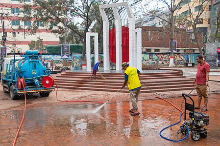 Workers clean the premises of Shaheed Minar for the upcoming International Mother Language Day which is annually observed on the 21st February. International Mother Language Day was proclaimed by the General Conference of UNESCO in 1999 to promote linguistic and cultural diversity and multilingualism.