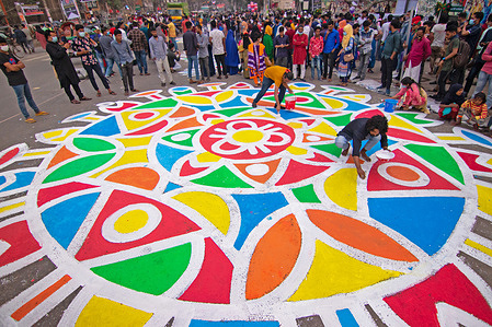 """General students make """"Alpana"""", a popular folk art form, on the premises of Shaheed Minar to commemorate International Mother Language Day. International Mother Language Day has been observed annually since 2000 to promote peace and multilingualism around the world and to protect all mother languages. It is observed on February 21 to recognize the 1952 Bengali Language Movement."""