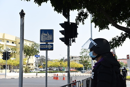 Thai police use containers and razor barbed wire fences arranged in a row to block anti-government protesters to pass through the Sanam Luang area  Before the Grand Palace in Bangkok.