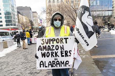 Rally organized by Workers Assembly Against Racism in support of Amazon workers of warehouse in Bessemer, Alabama rights to unionize at Union Square across of Whole Foods Market owned by Amazon.