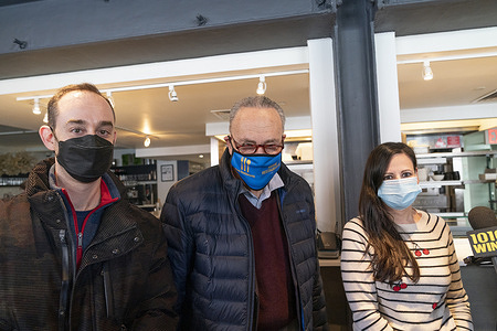 Senate Majority Leader Chuck Schumer flanked by restaurant owner Amanda Cohen and Executive Director of New York City hospitality Alliance Andrew Rigie presser on restaurant plight during pandemic at Dirt Candy restaurant. Senator Schumer highlighted statistics reported by New York City hospitality Alliance that about 92% of restaurant establishments struggle to pay December rent. Only this month restaurants started to serve people inside with restrictions for up to 35%. Senator announced that in Covid relief bill there is allocation specifically for restaurants to survive this pandemic.