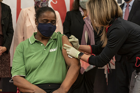 NAACP (National Association for the Advancement of Colored People) Lakeview Branch President Doris Hicks received Pfizer covid vaccine at Gateway Christian Center. Pop-up site was created on order by Governor Andrew Cuomo and serves a mostly underserved community of people of color who were hardest hit by the pandemic. Members of the local NAACP eligible for vaccination were inoculated and spread a message to their community of the importance of getting a vaccine.