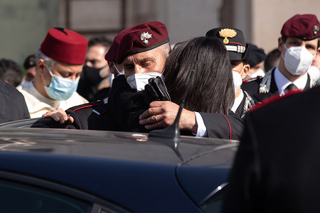 Relatives of carabiniere killed Vittorio Iacovacci after the funeral