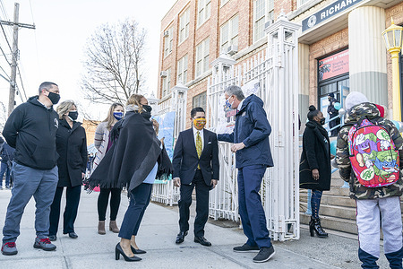 Mayor Bill de Blasio speaks to School Chancellor Richard Carranza during visit of Bronx Leaders of Tomorrow Richard R. Green Middle School on reopening day during COVID-19 pandemic. About 100 students signed up to attend school for in-person learning. Mayor was with school principal Joseph Biernat (black hoodie) and Bronc Executive Superintendent Meisha Ross Porter (black poncho). Following COVID-19 protocol school opened 3 entrances: one for girls, one for boys and one for staff in order to keep social distances.