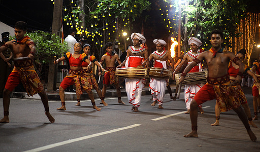 Sri Lankan Cultural Scenes Incorporated to Light the Ninth Perahara at the Hunupitiya Gangarama Viharaya.