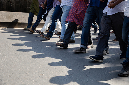 Activists march and slogans during a human chain procession, following the death of the writer Mushtaq Ahmed in jail months after his arrest under the Digital security act in Dhaka.