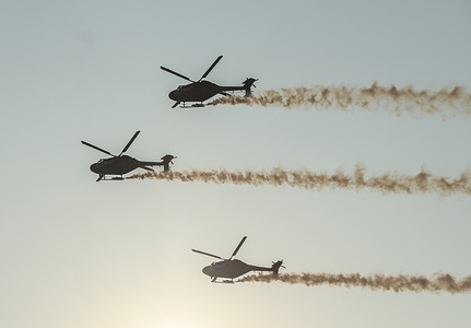 Sri Lanka Air Force and Indian Air Force perform aerobatics as they rehearse for a show to mark the 70th anniversary of Sri Lanka Air Force in Colombo.