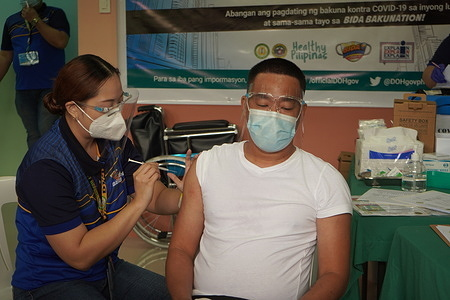 Philippines starts its COVID-19 vaccination drive with the first 600,000 doses of the donated Chinese vaccine CoronaVac in major government hospitals in Metro Manila.