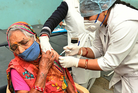 An elderly woman being administered COVID-19 vaccine, during a countrywide inoculation drive, at Government hospital in Beawar. The second phase of the Covid-19 vaccination drive started for people 60 years of age and above. 70 years old Indian Prime Minister Narendra Modi also received his first dose of Corona vaccine at AIIMS in New Delhi on Monday.