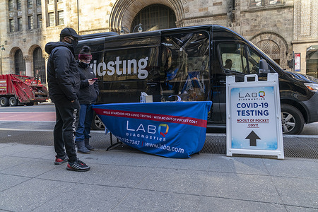 LabQ Diagnostics COVID-19 mobile testing site sponsored by NYS DOH seen at Grand Central Terminal. LabQ test are free for all and available in mobile sites around the city. LabQ set up 7 locations in Manhattan, 7 locations in Brooklyn, 3 locations in Queens and 4 locations in the Bronx. LabQ stated that their accuracy is 99.7% and their turnarround is up to 48 hours.
