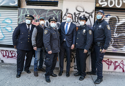 Police Commissioner Dermot Shea (3rd from R), Chief of Community Affairs Jeffrey Maddrey (1st from L), Donald West (2nd from L) pose with auxiliary officers after press conference to combat graffiti and improve quality of life on Orchard Street. Initiative to combat graffiti is designed to improve quality of life and to lower crimes in the city. Graffiti causes substantial financial costs to homeowners and merchants and public institutions and facilities. Graffiti is often related to drug and gang violence. There were more than 6,000 complaints in calendar 2020 about property damaged by graffiti.